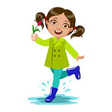 Girl With The Flower, Kid In Autumn Clothes In Fall Season Enjoyingn Rain And Rainy Weather, Splashes And Puddles