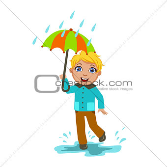 Boy Under Raindrops With Umbrella , Kid In Autumn Clothes In Fall Season Enjoyingn Rain And Rainy Weather, Splashes And Puddles