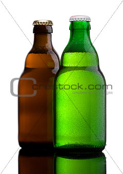 Green and brown beer bottles with dew on white