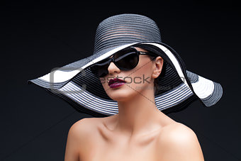 Beautiful girl in large hat