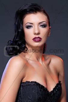 Beautiful girl in black corset