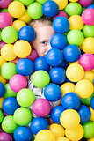 Child completely hid in colorful balls