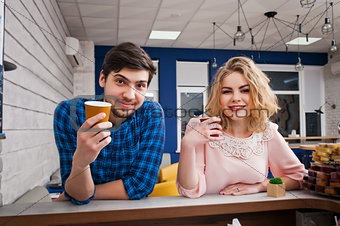 couple drinking coffee in the cafe
