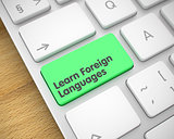 Learn Foreign Languages - Text on the Green Keyboard Key. 3D.