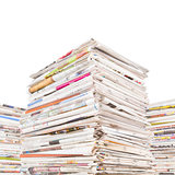 Three big stacks of newspapers