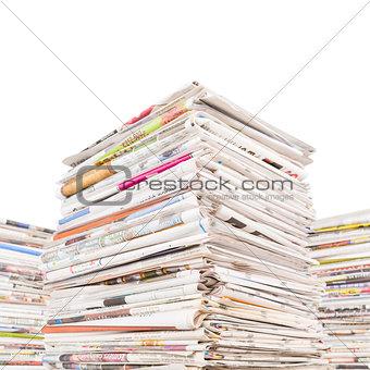 Three big stacks of newspapers