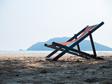 Deck chair on sandy beach