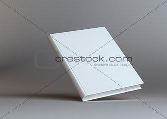 Blank empty book on grey studio background