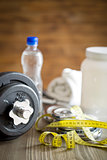 measuring tape and iron dumbbell