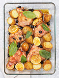 Baked chicken leg quarter with potatoes and lemon