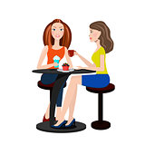 Two beautiful women sitting in a cafe and talking