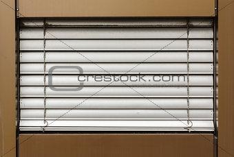 aluminum white blinds on the window