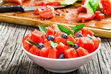 watermelon with blueberries and fresh mint , selective focus