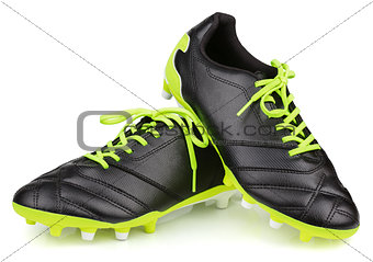 black leather football shoes or soccer boots isolated on white background