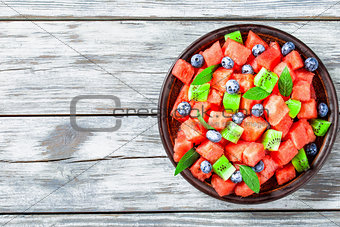 Watermelon and Blueberry salad on an earthenware dish top view