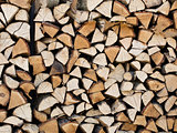 A stack of chopped firewood stacked on top of each other