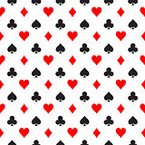 Seamless pattern background of poker suits - hearts, clubs, spades and diamonds - arranged in the rows on white background. Casino gambling theme vector illustration