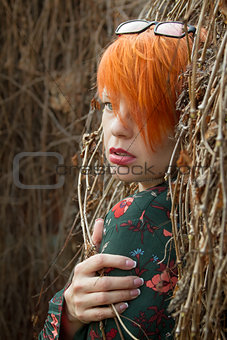 Beautiful girl with short red hair.