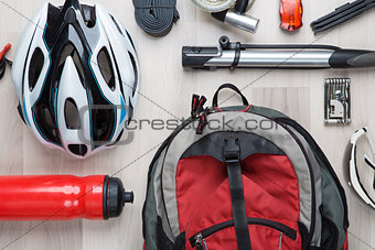 Cyclist accessories on wooden background