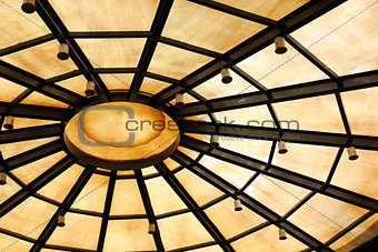 Background with circle structure under roof