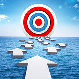 Big target on horizon of sea and arrows
