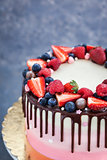 Delicious homemade cake decorated with chocolate and  fresh berr