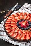 Delicious chocolate tart decorated with fresh berries