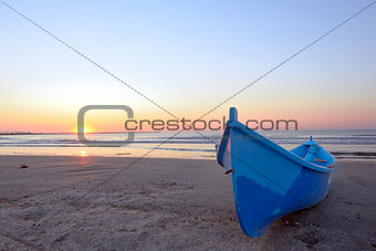 Fishing boat and sunrise