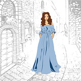 Fashionable romantic girl in blue maxi dress walking down the street
