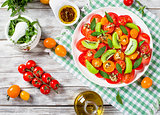 tomato, kiwifruit and mint salad with bottle of olive oil