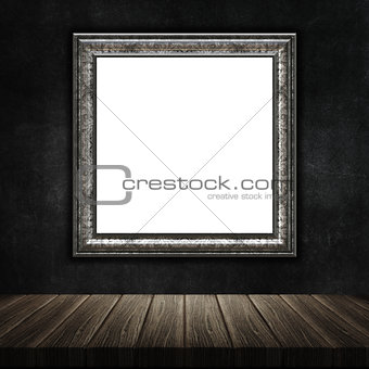 3D grunge picture frame with a wooden table against a grunge met