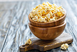 Wooden bowls with salted popcorn.