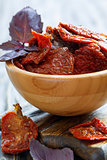 Sun-dried tomatoes and purple basil close-up.