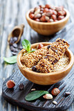Honey bars with chocolate and hazelnuts in bowls.