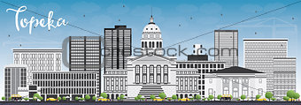 Topeka Skyline with Gray Buildings and Blue Sky.