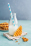 Tasty crispy waffles with milk