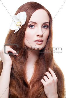 Beautiful girl with long red brown hair