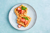 Homemade waffles with strawberries