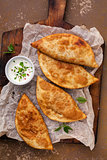 Chebureks fried in oil