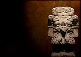 Grunge background with Aztec goddess of death Coatlicue