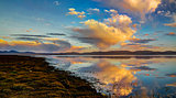 Panorama of Song Kul lake at the dawn Kyrgyzstan
