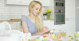 Young girl coloring eggs for holiday