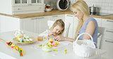 Loving family coloring Easter eggs