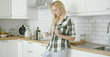 Lovely woman with phone in kitchen