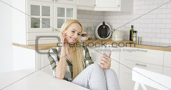 Charming female taking selfie in kitchen