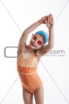Little girl in a orange swimsuit