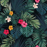 Seamless hand drawn tropical vector pattern with hibiscus flowers and exotic palm leaves on dark background.