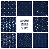 Set of hand drawn indigo blue patterns. Seamless vector triblal backgrounds with triangles and arrows.