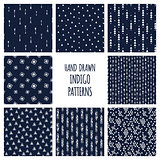 Dark blue indigo set of patterns. Hand drawn vector triblal backgrounds with triangles and arrows.