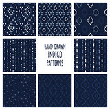 Set of hand drawn indigo blue patterns. Seamless vector navajo backgrounds with triangles, arrows, rhombuses and diamonds.